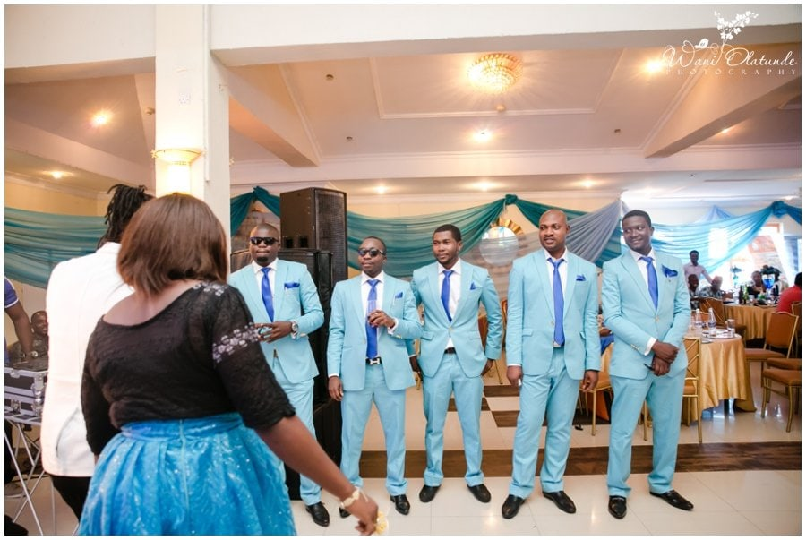 colourful groomsmen at tfc centre wedding in festac photo