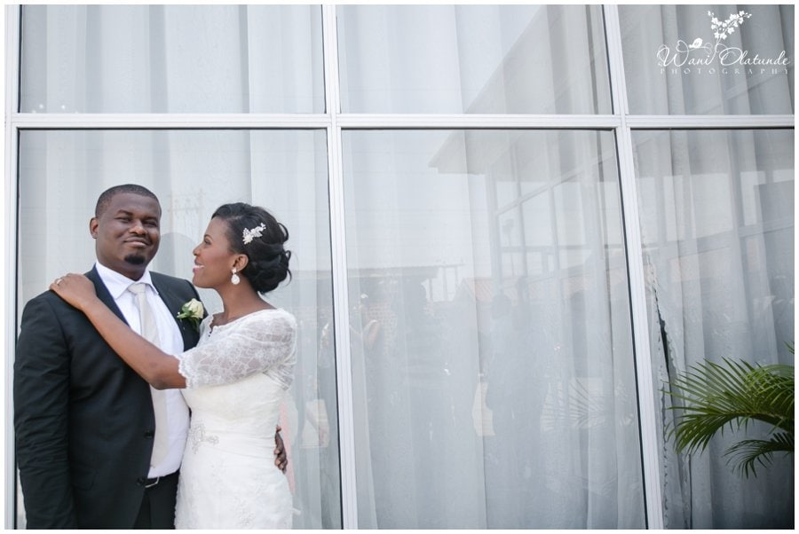 married couple with peach champagne cream blush wedding at kfa in lekki photo