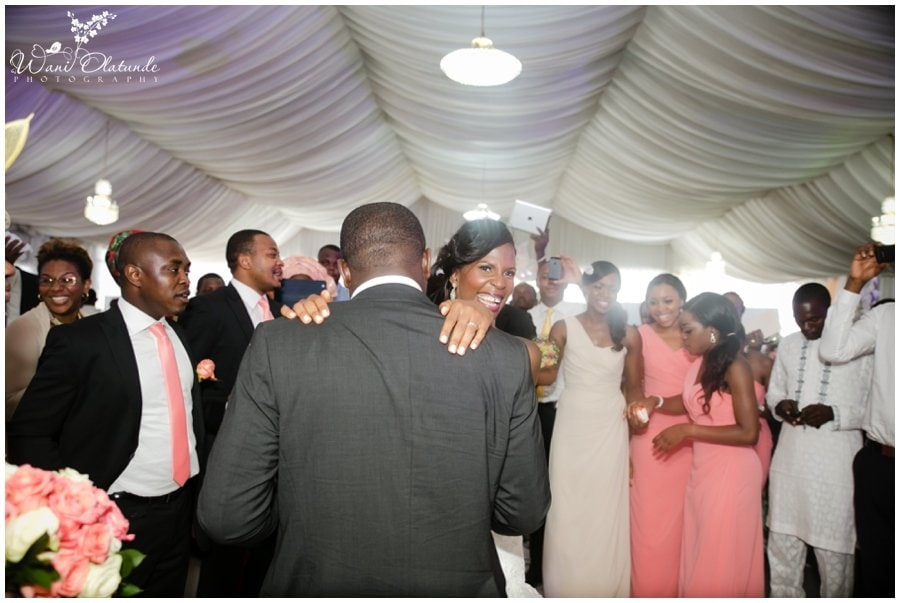 married couple dance at peach champagne blush cream wedding at kfa event place in lekki photo