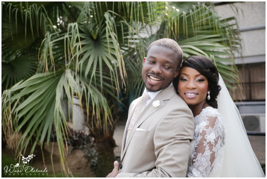 couples pose at rccg city of david in pink & champagne wedding in lagos
