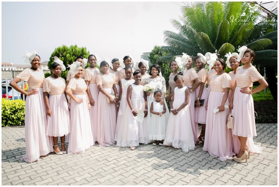 bridesmaids in pink and champagne dresses at wedding in lagos