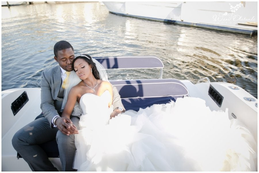 gorgeous nigerian couple pose on boat at dubai outdoor wedding