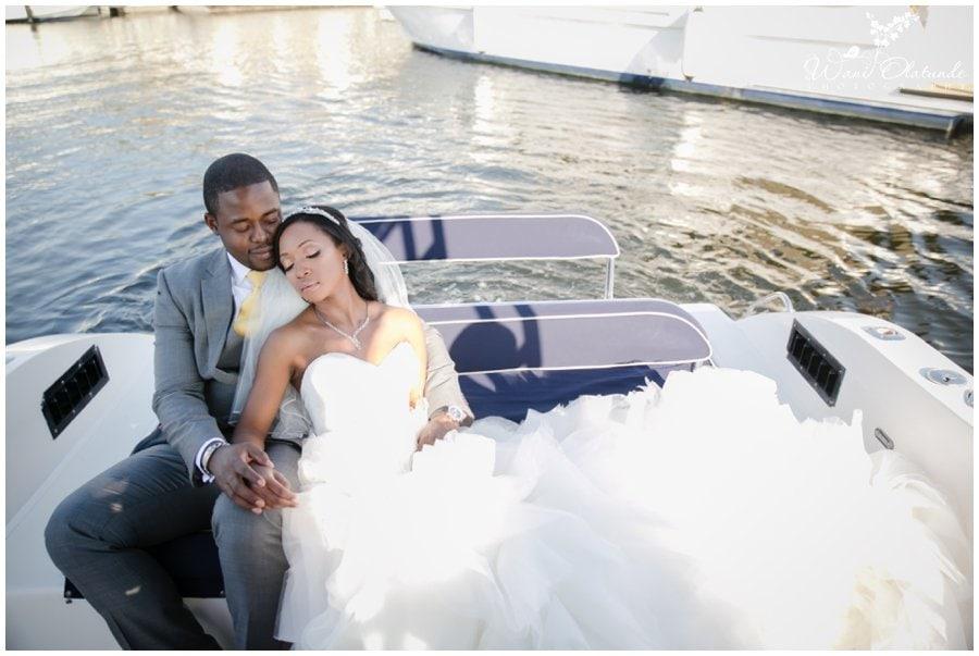 gorgeous nigerian couple pose on boat at dubai outdoor wedding