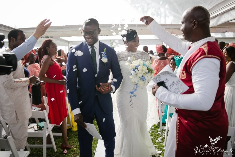 rose confetti thrown at outdoor federal palace wedding