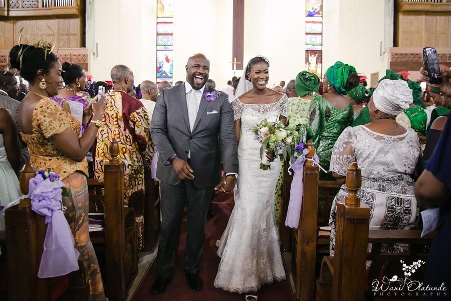 couple walking out of church happy wedding saviours church tbs