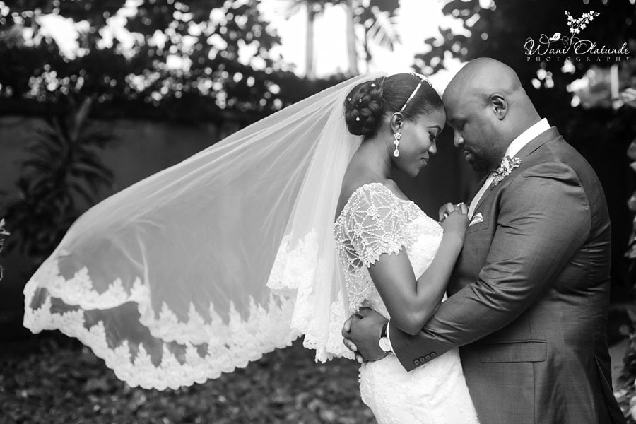 happy married couple posing clear essence lagos