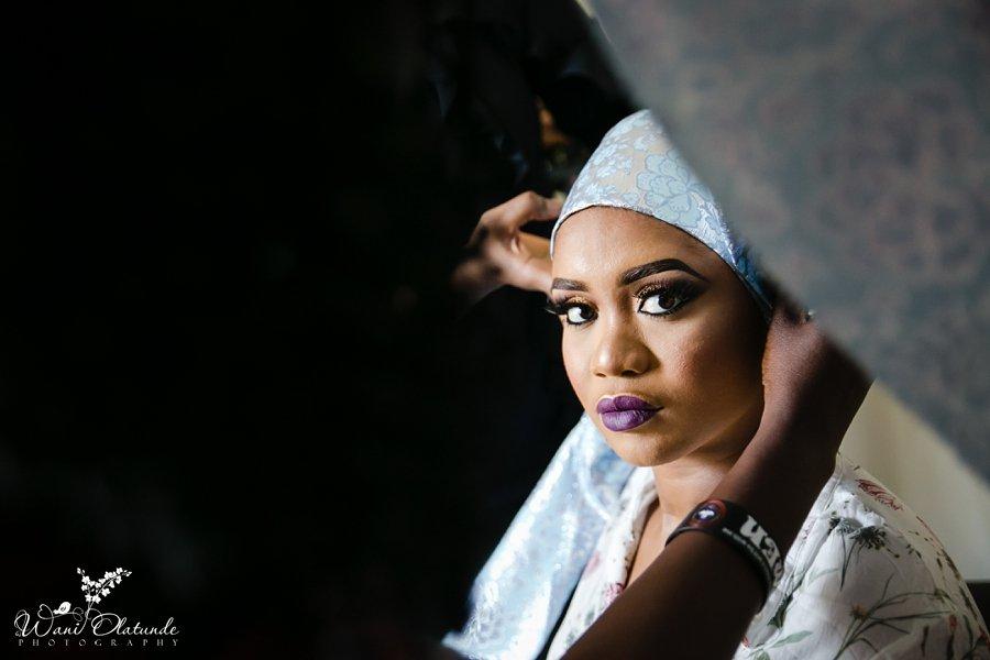 yoruba bride tying gele wani olatunde
