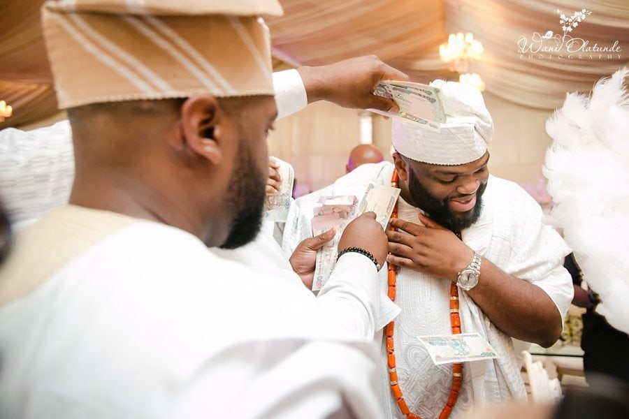 yoruba groom spraying wani olatunde wedding