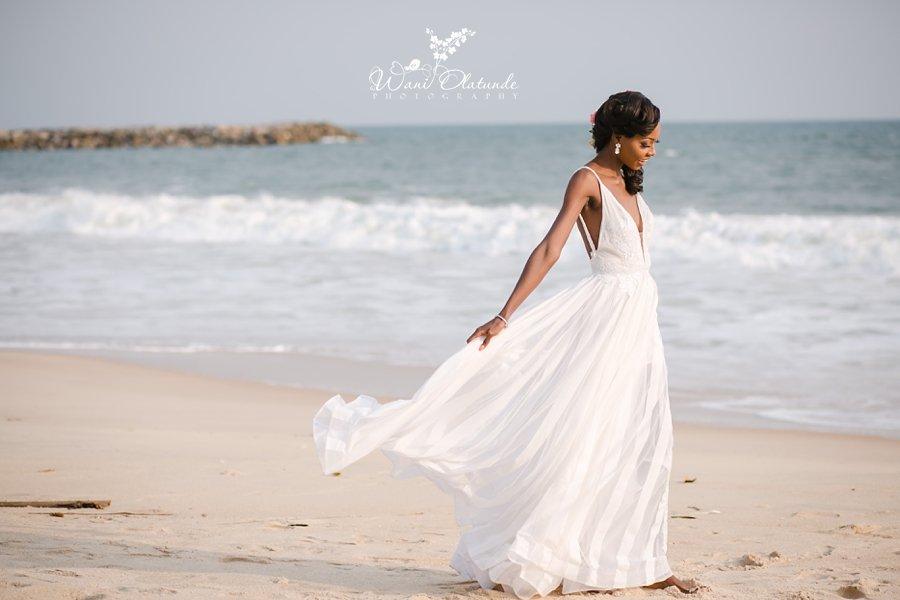 beautiful dramatic bride dress on a beach wani olatunde