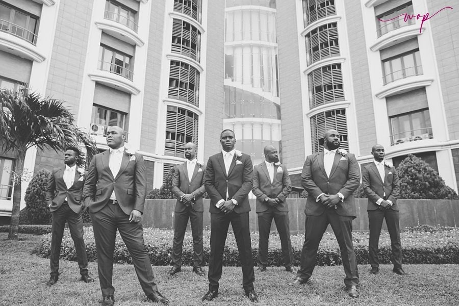 black and white groom groomsmen pose wani olatunde